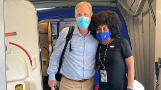 American Airlines CEO Doug Parker, left, and Southwest Airlines flight attendant JacqueRae Sullivan, right.