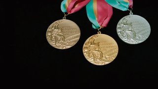 Gold, silver, and bronze Olympic medals from the 1984 Los Angeles Summer games.