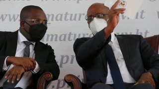 Haiti's designated Prime Minister Ariel Henry, right, and interim Prime Minister Claude Joseph speak during Henry's appointment as the new prime minister in Port-au-Prince, Haiti, Tuesday, July 20, 2021, weeks after the assassination of President Jovenel Moise on July 7.