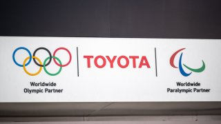 This picture shows a Toyota and Olympic and Paralympic games logos at a closed Toyota showroom in Tokyo on May 12, 2021.
