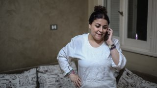 Egyptian activist and journalist Esraa Abdel Fattah speaks on the phone at her home after being released from prison.