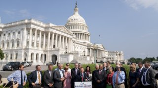 Representative Josh Gottheimer, a Democrat from New Jersey and co-chair of the House Problem Solvers Caucus, center, speaks during a news conference outside the U.S. Capitol in Washington, D.C., U.S., on Friday, July 30, 2021.