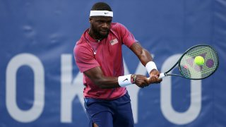 Frances Tiafoe competes in Tokyo