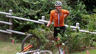 Mathieu van der Poel of Team Netherlands suffers a fall after jumps off a boulder