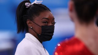Simone Biles watches women's team final
