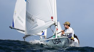 Charlie Buckingham of the United States waits to compete in the delayed Men's Laser class