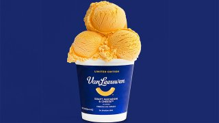 A tub of Kraft Macaroni & Cheese ice cream with three scoops on top.