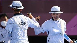 South Korea's Je-doek Kim and San An celebrate in the quarterfinals