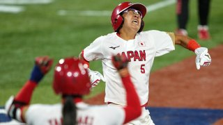 Japan third baseman Yu Yamamoto (5) reacts after scoring against the United States of America on an RBI single hit by designated player Yamato Fujita (not pictured) during the fifth inning in the gold medal game of the Tokyo 2020 Olympic Summer Games