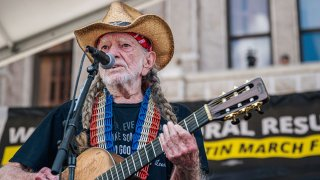 American musician Willie Nelson performs during the Georgetown to Austin March for Democracy rally on July 31, 2021 in Austin, Texas. Texas activists and demonstrators rallied at the Texas state Capitol after completing a 27-mile long march, from Georgetown to Austin, demanding federal action on voting rights legislation.