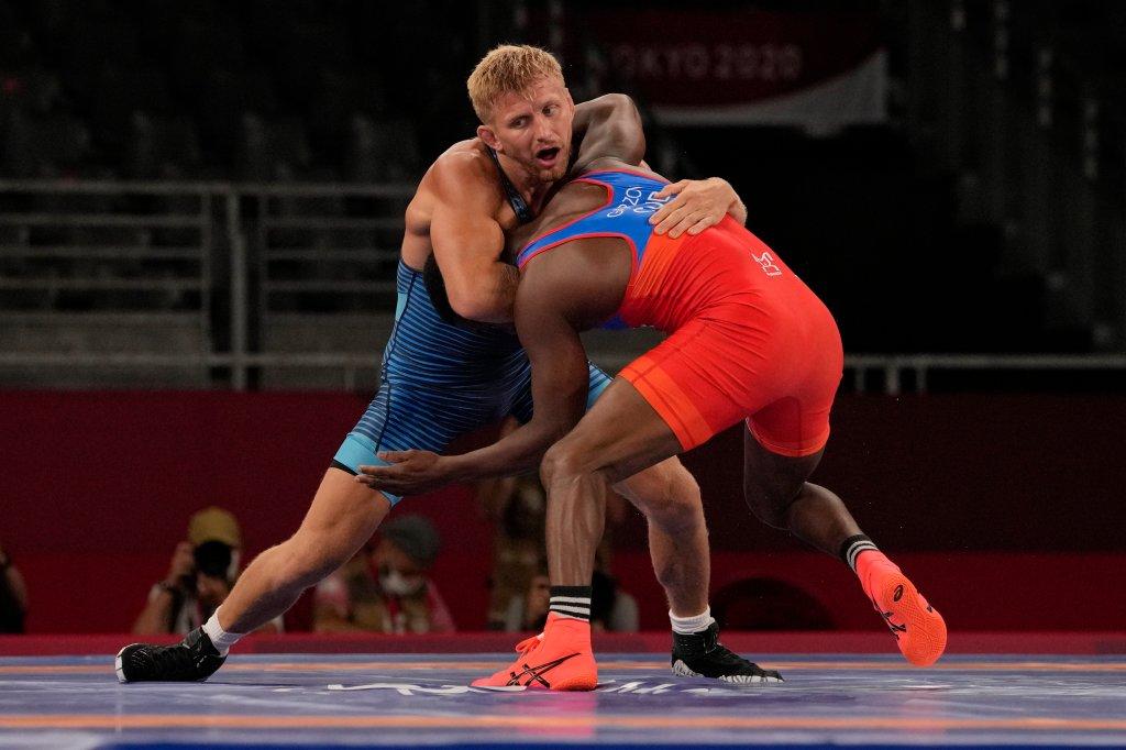 United State's Kyle Douglas Dake, left, competes against Cuba's Jeandry Garzon Caballero