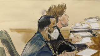 In this courtroom artist's sketch R. Kelly, left, listens during his trial in New York