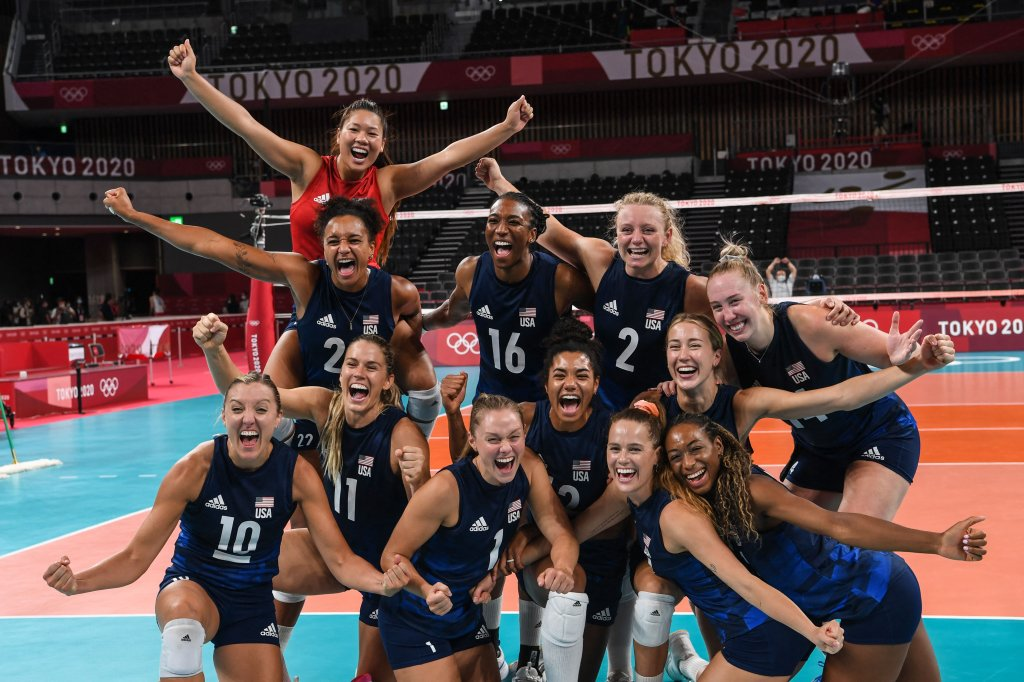 Team USA celebrates their victory in the women's semi-final volleyball match between USA and Serbia during the Tokyo 2020 Olympic Games at Ariake Arena in Tokyo on Aug. 6, 2021.