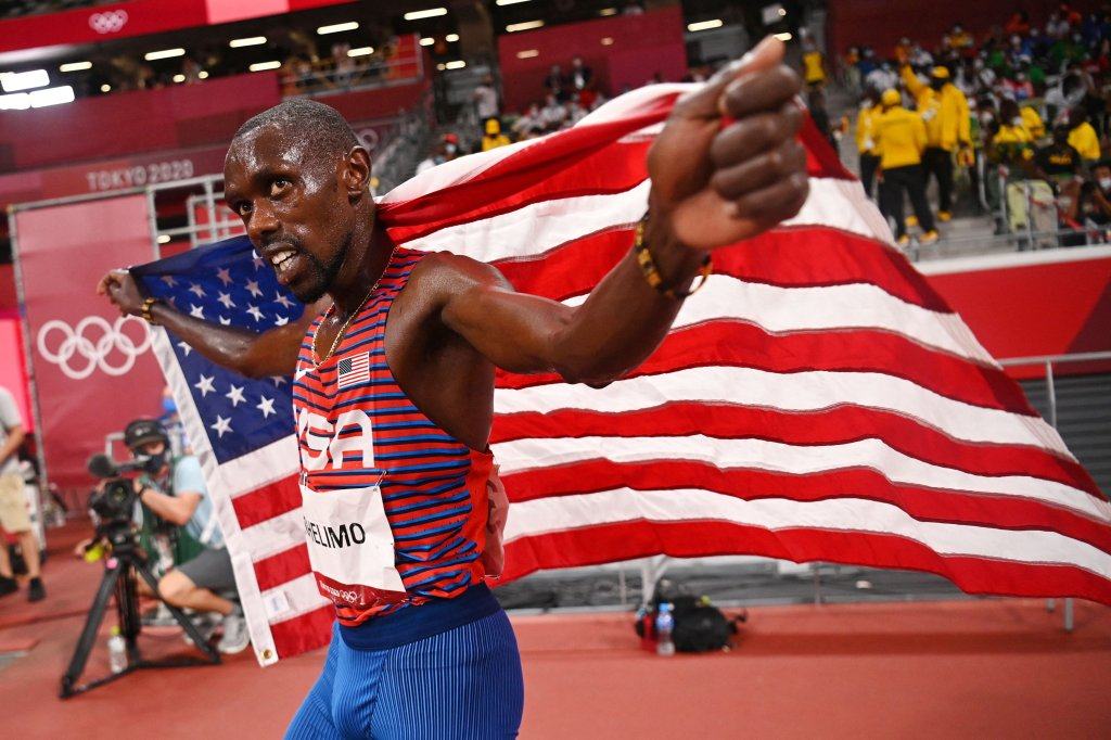 Team USA's Paul Chelimo celebrates with the national flag after winning the bronze medal in the men's 5000m final during the Tokyo 2020 Olympic Games at the Olympic Stadium in Tokyo on Aug. 6, 2021.