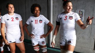 Ilona Maher, Kris Thomas and Abby Gustaitis of Team United States share a laugh as they prepare to take the field for the Women's pool C match between Team United States and Team Japan during the Rugby Sevens on day six of the Tokyo 2020 Olympic Games at Tokyo Stadium on July 29, 2021 in Chofu, Tokyo, Japan.