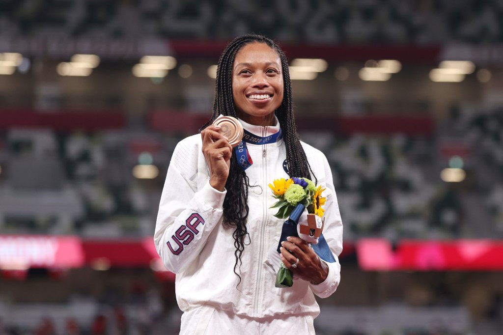 Bronze medalist Allyson Felix of Team USA holds up her medal on the podium during the medal ceremony for the women's 400m on day fourteen of the Tokyo 2020 Olympic Games at Olympic Stadium on Aug. 6, 2021, in Tokyo, Japan. Felix became the most decorated female athlete for track and field with her bronze medal win.