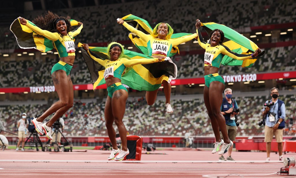 Briana Williams, Elaine Thompson-Herah, Shelly-Ann Fraser-Pryce and Shericka Jackson of Team Jamaica celebrate winning the gold medal in the Women's 4 x 100m Relay Final on day fourteen of the Tokyo 2020 Olympic Games at Olympic Stadium on Aug. 6, 2021 in Tokyo, Japan.