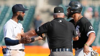 Jose Abreu #79 of the Chicago White Sox and shortstop Niko Goodrum #28 of the Detroit Tigers are kept apart by umpire Tim Timmons after Abreau was tagged out attempting to steal second base during the ninth inning at Comerica Park on September 27, 2021, in Detroit, Michigan