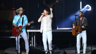 In this July 28, 2021, file photo, Brian Kelley, Tyler Hubbard of Florida Georgia Line and Thomas Rhett perform during CMA Summer Jam at Ascend Amphitheater in Nashville, Tennessee.