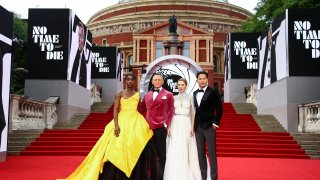 Lashana Lynch, from left, Daniel Craig, Lea Seydoux and Cary Joji Fukunaga pose for photographers upon arrival for the World premiere of the new film from the James Bond franchise 'No Time To Die'