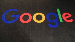 the logo of Google is displayed on a carpet at the entrance hall of Google France in Paris
