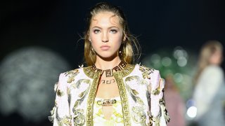 Lila Grace Moss walks the runway at a Versace special event during Milan Fashion Week on Sept. 26, 2021.