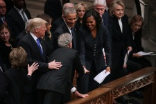 George W. Bush, Michelle Obama Share Inside Joke at George H.W. Bush's Funeral