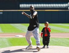 Kanye West, His Son Throw First Pitches at Crosstown Classic
