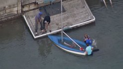 Pair Rescued from Overturned Sailboat