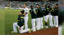 A's Catcher Becomes 1st MLB Player to Kneel for Anthem