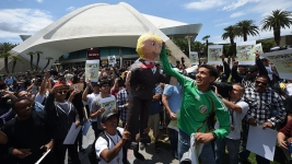 Trump Pinata Pummeled, Protesters Arrested at Calif. Rally