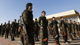 Syrian Kurdish-Led Fighters Take Last Town Held By ISIS