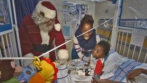 Santa Brightens Babies' Christmas in Hospital