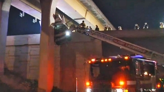 RAW VIDEO: Firefighters Pull Driver From Dangling Truck