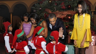 Obamas Merrily Mingle With Elves