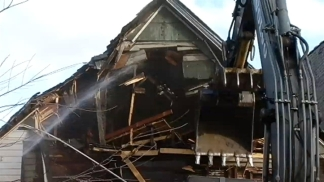 Time-Lapse: Crews Demolish Drug House