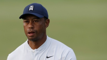 Woods Withdraws From Northern Trust, Citing Oblique Strain