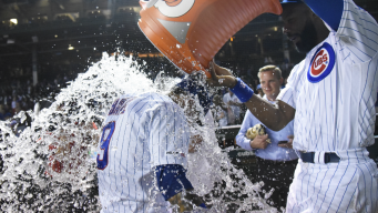 Cubs Hold Off A's for Wild 6-5 Win