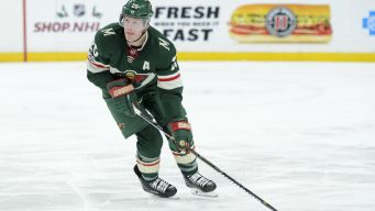 Ward Shines, but Blackhawks Fall to Wild in Overtime