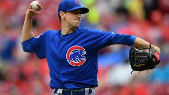 Cubs' Bats Go Silent in Extra Inning Loss to Reds