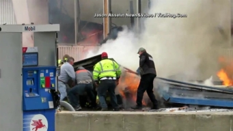 Gas Station's Burning Roof Collapses on Michigan Firefighter