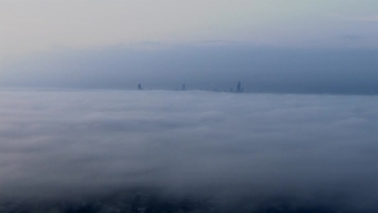 Stunning Footage Shows Chicago Skyline Covered by Fog