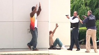 Police Draw Guns on Men Opening Bank Account