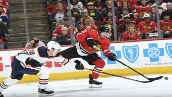 Crawford Lead Blackhawks to 1st Win, 3-1 Over Oilers