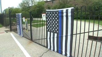 Flags Honoring Officers Ripped Down, Torn Up in Suburbs