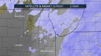 Snow Continues to Fall Across Chicago Area