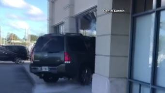 Woman Intentionally Crashes SUV Into Store