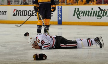 Rozsival Struggles Again as Hawks Fall