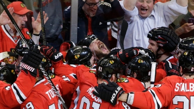 Hawks Advance, Beat Red Wings in OT