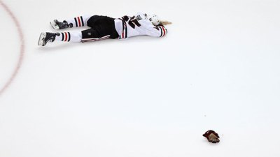 Andrew Shaw Hit in Face By Puck